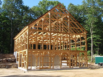 English: A rough-sawn hemlock timber frame hor...