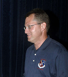 Profile view of Author Dave Pelzer, facing left