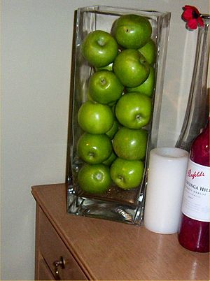 A picture taken, of Green Apples in a jar.