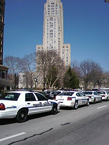 Police cars along Forbes Avenue near the Cathedral of Learning during the funeral ceremony.