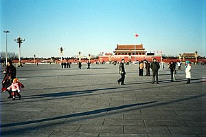 Groups of people wander around Tiananmen Squar...