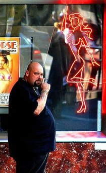 A bouncer in front of a strip club in San Fran...