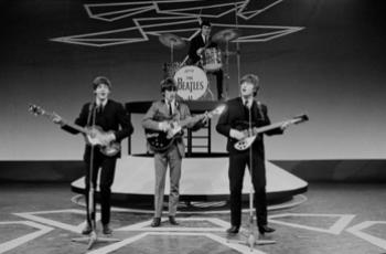 English: Paul McCartney, George Harrison, Jimm...