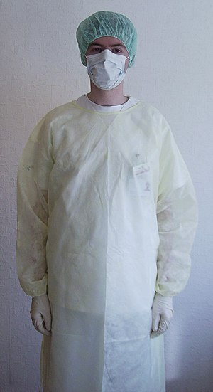 hospital staff member clothed in protective cl...