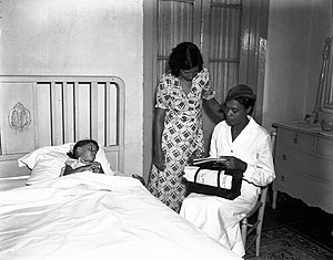 Nurse making house-call, New Orleans, 1936. Or...