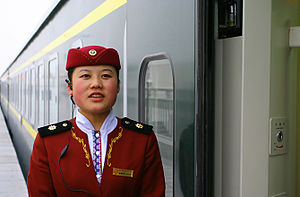 Rail attendant. On a slow train from Xining to...
