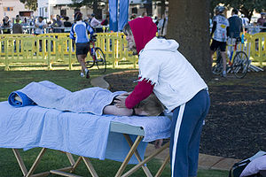 Massage therapist working at a Triathlon in Fr...