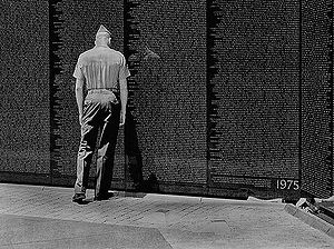A Marine at Vietnam Memorial on 4th July 2002