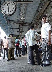Commuters wait for a train on the Harbour line at Bandra