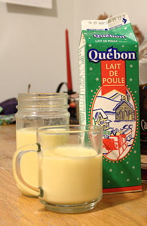 Glasses and a carton of eggnog (called by its ...