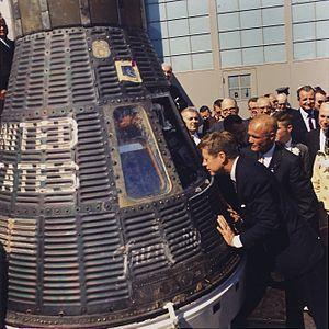 President John F. Kennedy inspects Mercury cap...