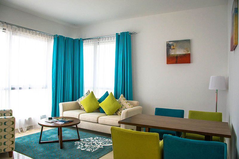 Interior Design On A Budget Lime Green And Turquoise Blue Living Room With  Wrap Around Curtains
