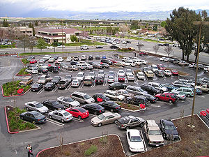 A parking lot with landscaping and a diagonal ...