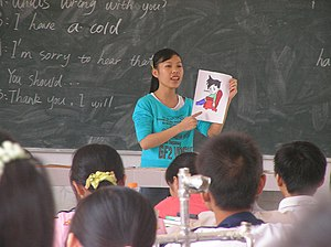 Student teacher in China teaching children Eng...