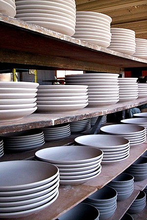 A set of plates ready to be glazed at a cerami...
