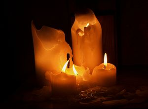 Picture of several candles melting in the dark...