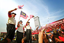 Najib and his wife Rosmah waving flags during the Malaysia Day celebration in Kuala Lumpur, 16 September 2011