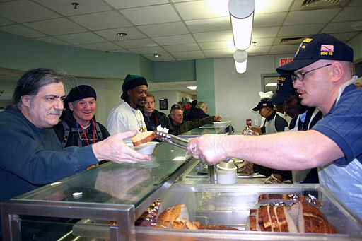 US Navy 070202-N-8110K-044 Sailors assigned to guided missile destroyer USS Mahan (DDG 72) serve lunch to homeless veterans at the New England Shelter for Homeless Veterans