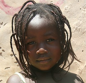 English: Young girl on a market in Ouagadougou...