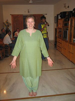 Western woman in Hyderabad wearing a green cot...