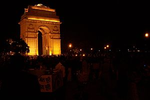 Crowds around India Gate on pleasant night. Ta...