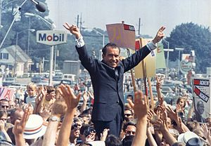 "Nixon gives his trademark ""victory"" ..."
