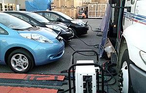 English: Three Nissan Leaf electric cars recha...