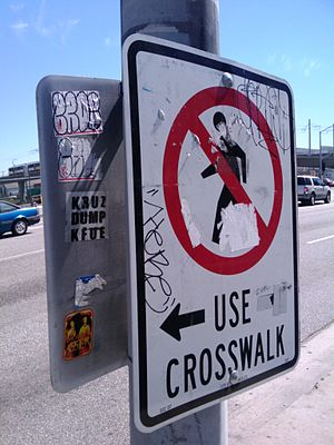 English: A sign ordering pedestrians not to cr...