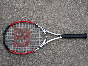 A Wilson brand tennis racquet with a Roger Fed...