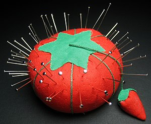 English: A pincushion (sewing), with pins. The...