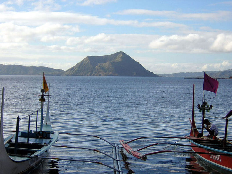 View of the Taal Volcano from the lake with local fishing boats on the foreground.  Photo by Jhun80.
