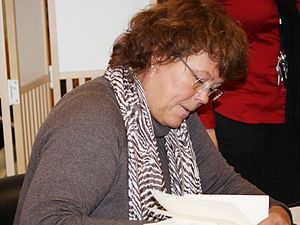 English: Norwegian writer Anne Holt signing he...