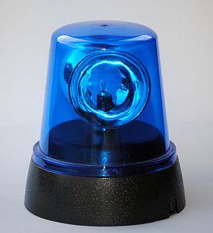A blue flashing light. Français : Un gyrophare...
