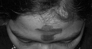 Salib abu di dahi sebagai lambang pertobatan y...