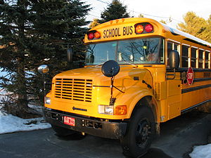 Front of a yellow school bus.