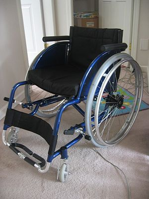 A blue folding lightweight wheelchair.
