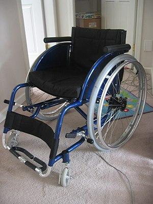A blue folding lightweight wheelchair.
