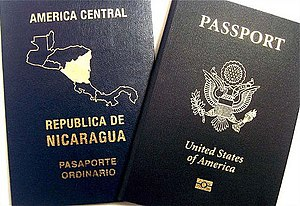 English: A dual citizen may bear two passports...