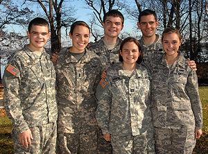 Capt. Kate Gowel, bottom row, left, poses for ...