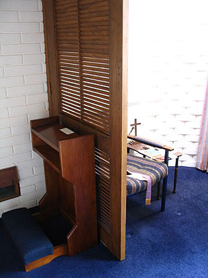 English: Modern confessional in the Church of ...