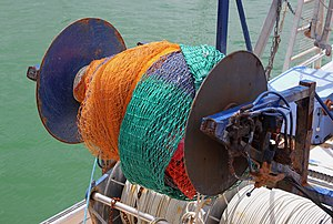 English: Fishing nets wound up around a winch ...