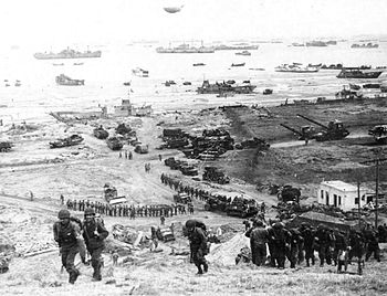 The build-up of Omaha Beach: reinforcements of...