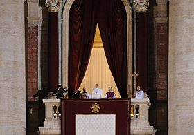 Francis appears in public for the first time as pope, at St. Peter's Basilica balcony, 13 March 2013.
