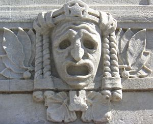 Tragic mask on the façade of the Royal Dramati...