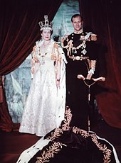 Elizabeth in crown and robes next to her husband in military uniform