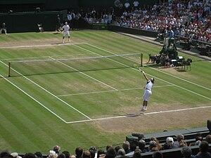 Roger Federer receives Rafael Nadal's serve du...