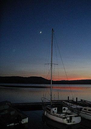Boats at Waterhead, Ambleside. Sunset beyond L...