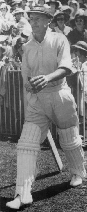 Don Bradman walks out to bat at the Melbourne ...