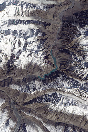 Dark rock covers the river in the upper left c...