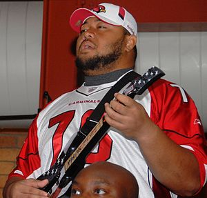 Deuce Lutui displays his musical talents along...